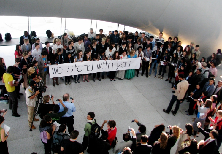 Youth at COP 18 stage a solidarity action with the Philippines